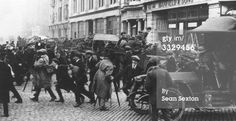 A convoy of Black and Tans, an armed auxiliary force of the Royal Irish Constabulary, and British soldiers arrives at the junction of Middle Abbey Street and O'Connell Street, Dublin, during the War of Independence. Ireland 1916, Dublin Ireland, Stock Pictures, Old Pictures, Blue Green Eyes, British Soldier, Ares, Second World, Northern Ireland