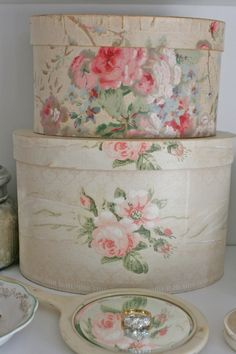 Vintage wallpaper boxes make a charming decorative element.