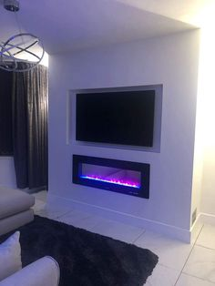 Modern Electric Fireplace, Electric Fireplaces, Modern Fireplace, Wall Mounted Electric Fires, Wall Mount Electric Fireplace, White Lounge, Mounted Tv, Black Walls, Warm And Cozy