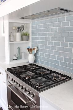 Subway tiles, storage/shelves near cooktop