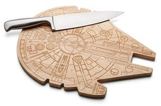 """This Star Wars Millennium Falcon Wooden Cutting Board will chop veggies in less than 12 parsnips. Dice and slice on the coolest Star wars ship ever.  It measures 10 1/2"""" x 14 1/2"""" inches. Better get chopping.    Star Wars Millennium Falcon Wooden Cutting Board  Officially-lice"""