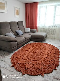 """Fox Tail Rug"" is an oval-shaped carpet/rug which can be turned into a doily by taking smaller hooks and thread/light fingering yarn weights. Doily Rug, Doilies, Oval Rugs, Fingering Yarn, Large Rugs, Crochet Home, Rugs On Carpet, Ravelry, Crochet Patterns"