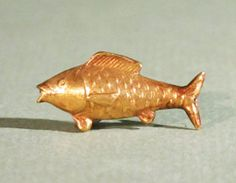Egyptian Gold Amulet of a Fish. This and more ancient jewelry for sale on CuratorsEye.com