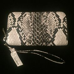 Beautiful snack skin wristlet  Black and white / gray tones, snake skin wristlet! Brand new with tags! Will fit an iPhone 6plus! Very roomy and styling! Silver zipper. Bags Clutches & Wristlets