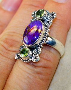 Handmade Artisan 925 Solid Sterling Silver Ring with Purple Copper Turquoise, Peridot ! Only one piece available and ready to ship! All items are one of a kind and Unique Worldwide! RING DETAILS: WEIGHT: 9.00 grams MATERIAL: Solid Sterling Silver MAIN STONE: Purple Copper Turquoise OTHER STONES: Peridot HEAD SIZE: L - 1 1/8, W - 3/8 RING SIZE: 7 STAMP / MARK: 925 CONDITION: New We bring to you the best quality exclusive handcrafted jewelry. All of these pieces are one of a k...