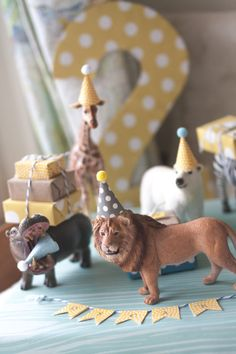 Tiny party hats on plastic animals.