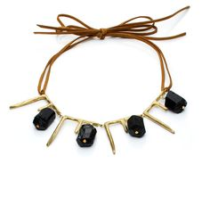 """icicles and bricks  Brass with black tourmaline on ultra suede  SIZE: 2"""" drop x 6"""" across  LENGTH: 16"""" - 24""""  Please allow 1-2 weeks for delivery."""