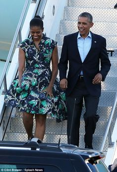 President Barack Obama and first lady and Michelle Obama arrive on air force one at Palm Springs airport. Michelle Obama had a dress malfunc...