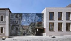 reiner john links historic building to extension with glass façade