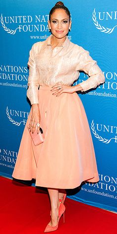 JENNIFER LOPEZ wearing a monochromatic peach outfit (from her lips to her toes!) in a very ladylike silhouette (including a Christian Siriano top and skirt) at the UN Foundation's gender equality discussion in N.Y.C. From: People.com