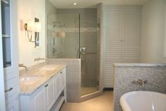 I like the idea of a standalone linen closet next to the shower.
