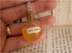 Felix Felicis in glass vial necklace - harry potter jewelry - silver plated chain. $14.95, via Etsy.