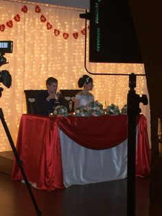 Sweetheart table elevated on dance floor.