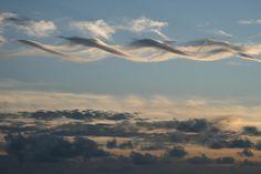 dna shaped clouds over Switzerland (Colllider?) That's weird!