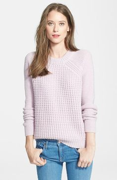 Mixed knits lend lush, touchable texture to a cozy raglan-sleeve pullover crafted from a cashmere-softened wool blend.