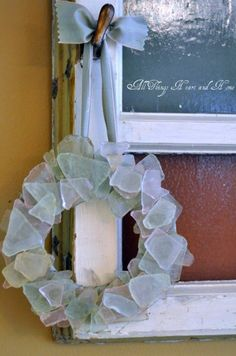DIY Seaglass Wreath. Wrap ribbon on a pre-form wreath ring and leave enough to hang. Glue the ribbon to the ring and then the seaglass pieces to the ribbon.