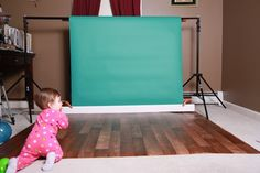 Set up with faux flooring and seamless paper - JustMommies Message Boards. Awesome, cheap backdrop