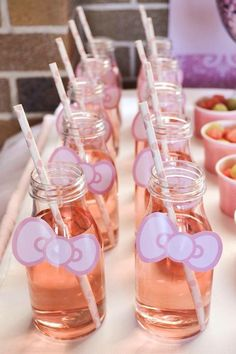 Pink Hello Kitty themed drinks. This is a great idea for a Hello Kitty themed baby shower.