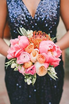 Navy Sequin Bridesmaid Dress with a Coral Peony Bouquet | Onelove Photography on @heyweddinglady via @aislesociety