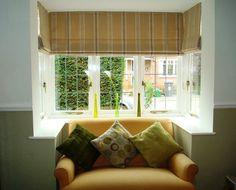 Blinds probably best for awkward window shape