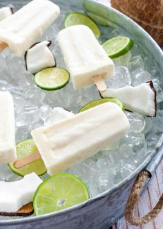 Summer coquito is a simple coconut rum and soda cocktail chilled and served with a creamy coconut popsicle. Popsicle cocktails are a great way to stay cool. Frozen Desserts, Frozen Treats, Alcoholic Popsicles, Mantecaditos, Popsicle Recipes, Summer Cocktails, Frozen Cocktails, Summer Treats, Gastronomia