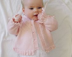 Baby girls sweater with detailed bodice and frilled hemline and cuffs Knitting pattern by OGE Knitwear DesignsThis pretty little girls jacket/sweater has beautiful detail on the bodice and a frilly cuff on the sleeves and hemline. Would also look bea Baby Cardigan, Baby Pullover, Cardigan Pattern, Jacket Pattern, Neck Pattern, Free Pattern, Little Girls Jackets, Baby Girl Jackets, Sirdar Knitting Patterns