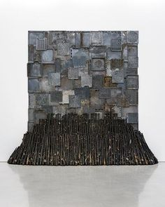 NARI Ward Iron Heavens, 1995 Oven pans, ironed cotton, and burnt wooden bats 140 × 148 × 48 inches 355.6 × 375.9 × 121.9 cm.