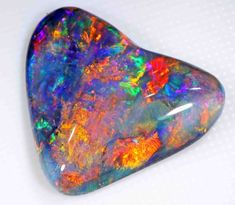 "VERY BRIGHT BLACK OPAL - 9.55 CTS - ""THE HEART"""