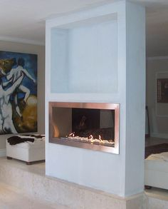 Stainless steel double sided fireplace. Decor looks very minimalist as well. Nice.