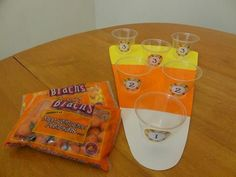 Candy Corn Toss teams race to see who can get the most candy corn in the cups in 2 minutes.