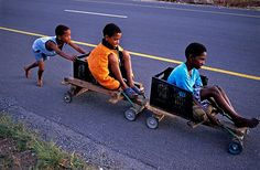 Homemade kid cars and bright yellow ropes keep these South African children busy at play, as they enjoy the natural resources they are crafty enough to turn into awesome toys.