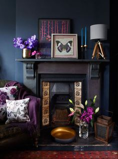 Deep colours are bang on-trend but need contrast to shine. If you have a black fireplace, try pairing it with reflective textures, such as glowing bronze metallics and warm copper, and some jewel tones with flowers. Add a few different floral displays, too.