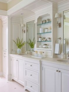 Double Sink Design Ideas, Pictures, Remodel, and Decor - page 72. Cabinet between sinks with curvy detail at top.
