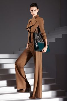 Loving this Escada pantsuit. The short jacket with cascading shawl collar is lovely.