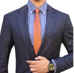 Burnt orange skinny tie paired with a tonal blue striped button down and navy blazer.