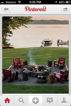 Fire pit by the lake with Adirondack chairs and a cool boat-- Would work perfectly on our lakeshore!