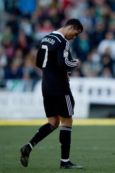 Cristiano Ronaldo (R) of Real Madrid CF leaves the pitch after being reprimanded with a red card during the La Liga match between Cordoba CF and Real Madrid CF at El Arcangel stadium on January 24, 2015 in Cordoba, Spain.
