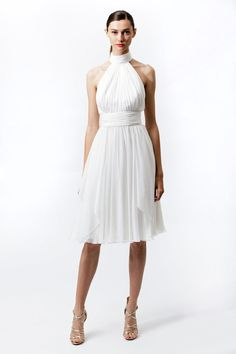 This wedding dress is beautiful and elegant with high collar and sleeveless design. The skirt looks flowing with knee length. Free made-to-measurement service for any size. Available colors seen as in Color Options.