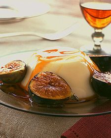 """Although the name panna cotta -- Italian for """"cooked cream"""" -- is simplicity itself, the taste and texture of these eggless custards are complex. Silky and rich but delicate, they are subtle enough to defer to any sweet accompaniment -- in this case, dark caramel and ripe figs. Heavy cream is simmered with sugar and gelatin, and transferred to an ice bath; the mixture is whisked until cool, flavored with a dash of vanilla, and poured into ramekins. Once set, each panna cotta is turned onto a…"""