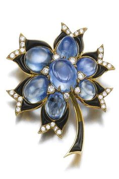 Sapphire, onyx and diamond brooch, Bulgari Of floral design set with cabochon sapphires, polished calibré-cut onyx and brilliant-cut diamonds, signed Bulgari, French assay and maker's marks, onyx segment deficient.