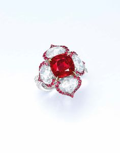 """A superb 5.01 carats Burma """"pigeon's blood"""" cushion-shaped ruby and diamond ring"""