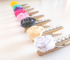 Set of 50 glamorous paper rose clothespins - wedding escort card/place card holders. $35.00, via Etsy.