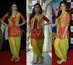 Alia in an orange kurta, flourescent yellow patiala and teamed it up with a yellow vest by Arpita Mehta.