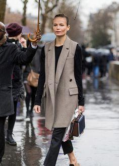 Model Natasha Poly wearing a vest wool coat outside Mugler on March 4 2017 in Paris France