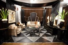 Danielle's Parisian-styled Art Deco lounge with its gray and black graphic floor, sculptured lamps and black-panther statue. Judge Genevieve Gorder praised her for softening up the style with a warm color palette of soft peaches and pink.