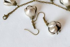 Golden leather flower earrings
