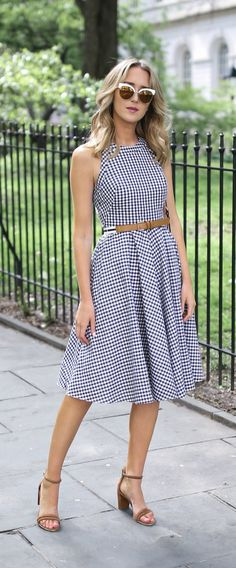 navy and white gingham fit and flare sleeveless midi dress with striped brown belt and cut out back // classic summer style // white cat eye sunglasses // brown suede leather block heel sandals
