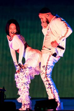 Rihanna and Drake on stage performing 'Work' Celebrity Couples.