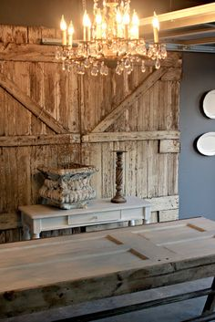 Reclaimed doors turned into a table and a killer and oh so rustic wall art.