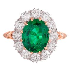 2.73 Carat Emerald Diamond Gold Cluster Ring | From a unique collection of vintage cluster rings at https://www.1stdibs.com/jewelry/rings/cluster-rings/